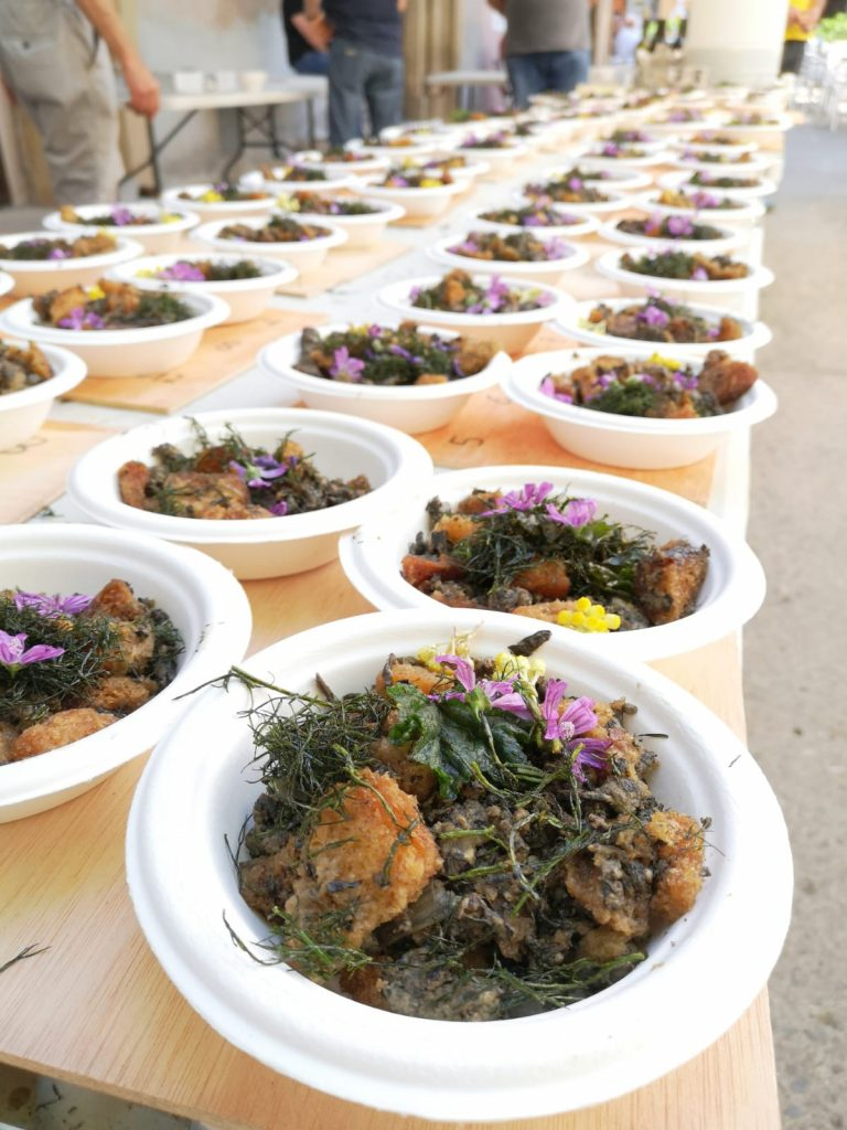 """Tasting of meals made with wild vegetation during """"Gastronomic Day of Forgotten Plants"""" in Igualada (Catalonia) organized by the """"Eixarcolant"""" group."""