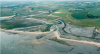 Aerial view of managed realignment at low tide - Photo credit: UK Environment Agency